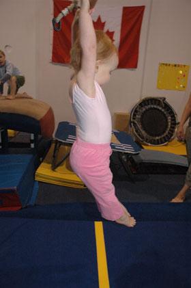 Julia at Gymnastics on Trapeze