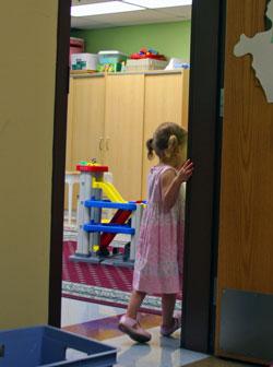 Julia at school classroom door