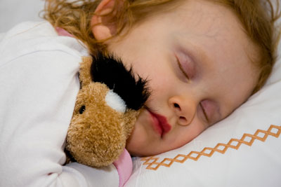 Wordless Wednesday — Julia Snuggling Her New Stuffy