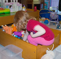 Julia sorting toys in the drawer