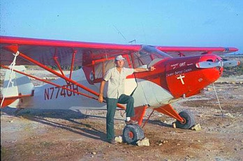 Jim Cooper in front of his prized plane.