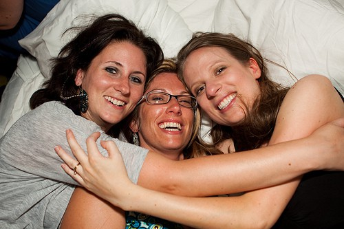 Laughing on the Beds at the CheeseburgHer Party