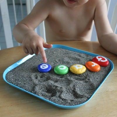 painting rocks with preschooler