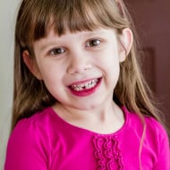Wordless Wednesday — Sophia Loses Her First Tooth!