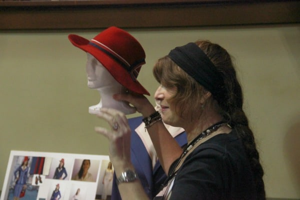 Agent-Carter-Wardrobe-Gigi-Melton-holds-red-hat