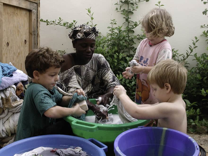 It took a while for the European washing machine to be shipped from Spain. Here are the 3 kids learning how to wash clothes the African way.