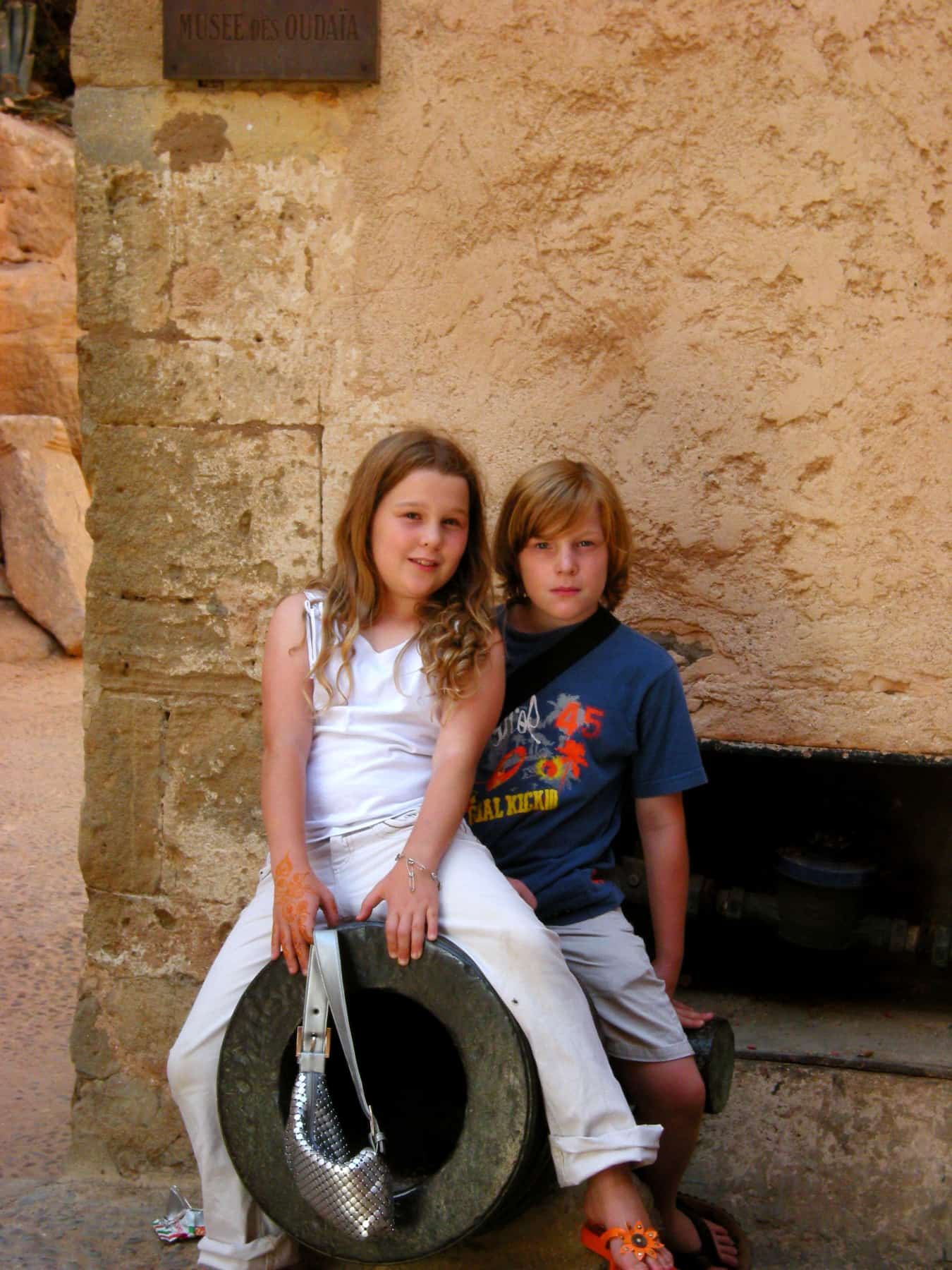 The twins, age 11, posing on a cannon at an old Moroccan fort in Rabat.
