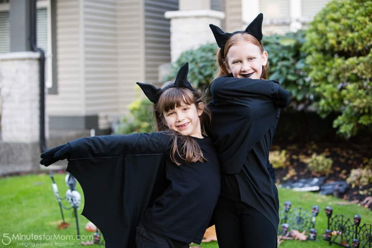 Julia and Sophia bat costumes trick or treating