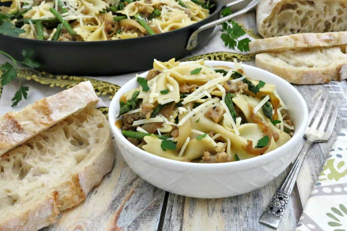 Bowtie Pasta with Chicken Italian Sausage Asparagus and Caramelized Onions