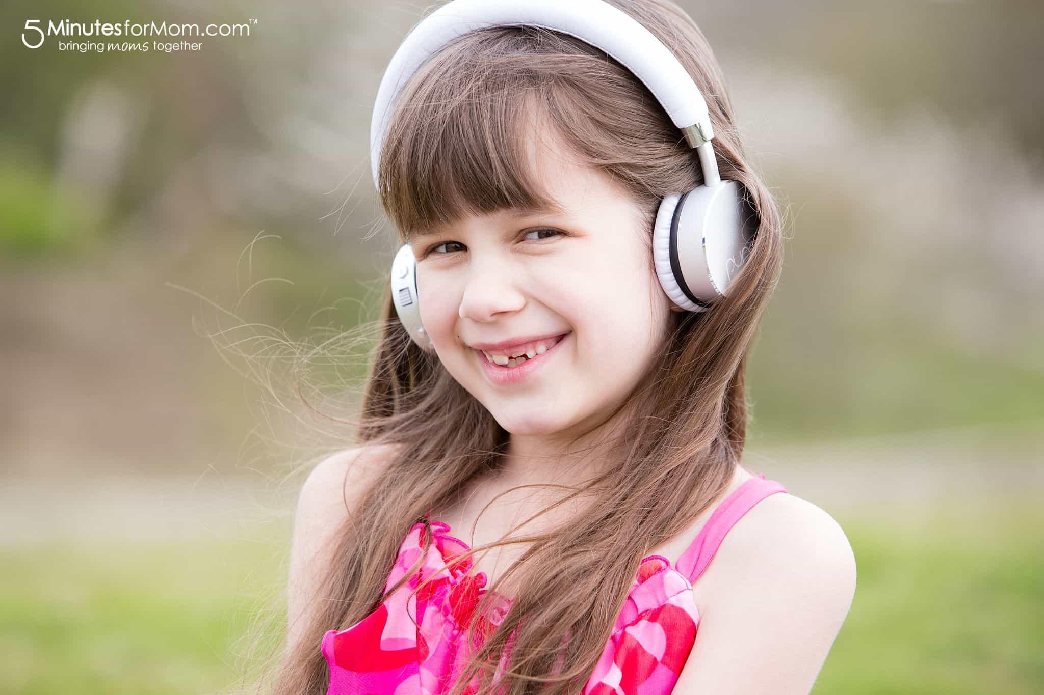Sophia Wearing Puro Sound Labs Headphones