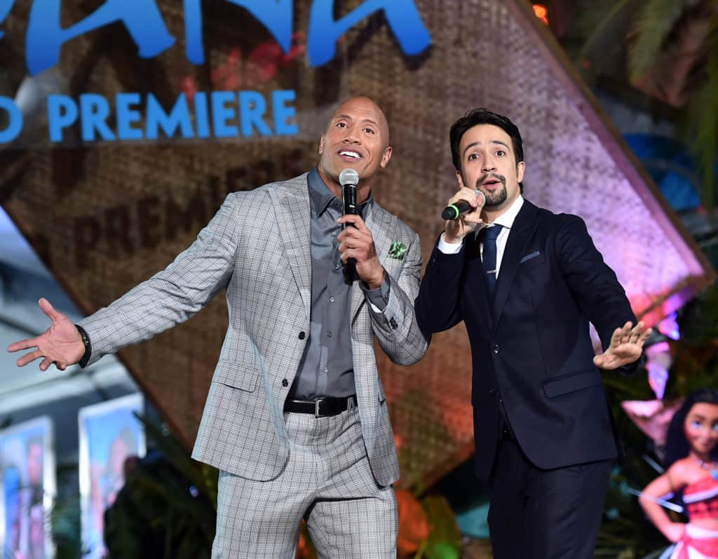 """Actor Dwayne Johnson and songwriter Lin-Manuel Miranda perform onstage at The World Premiere of """"MOANA"""" (Photo by Alberto E. Rodriguez/Getty Images for Disney)"""