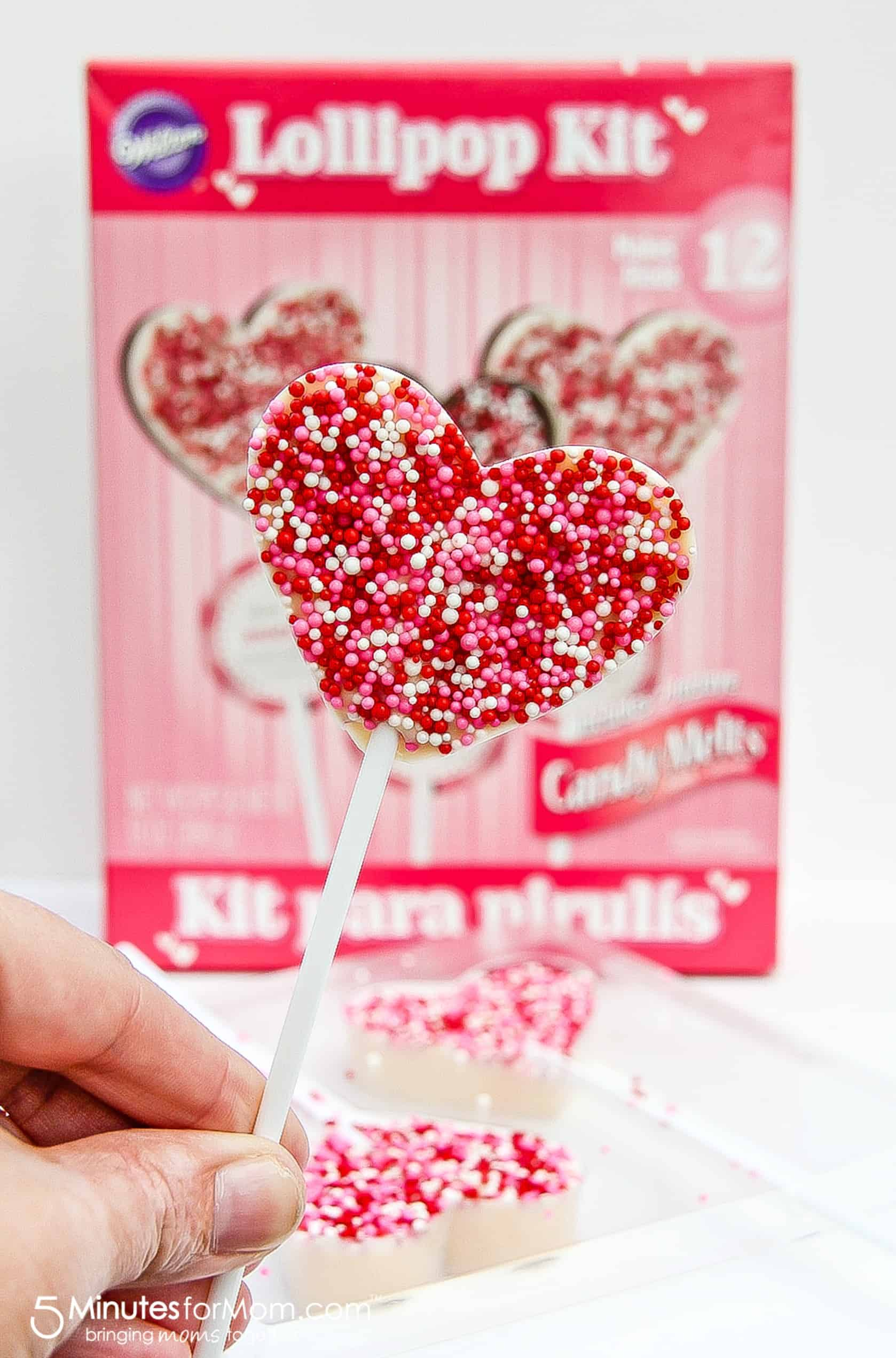 Make heart-shaped chocolate lollipop classrsoom treats with these easy kits from Party City