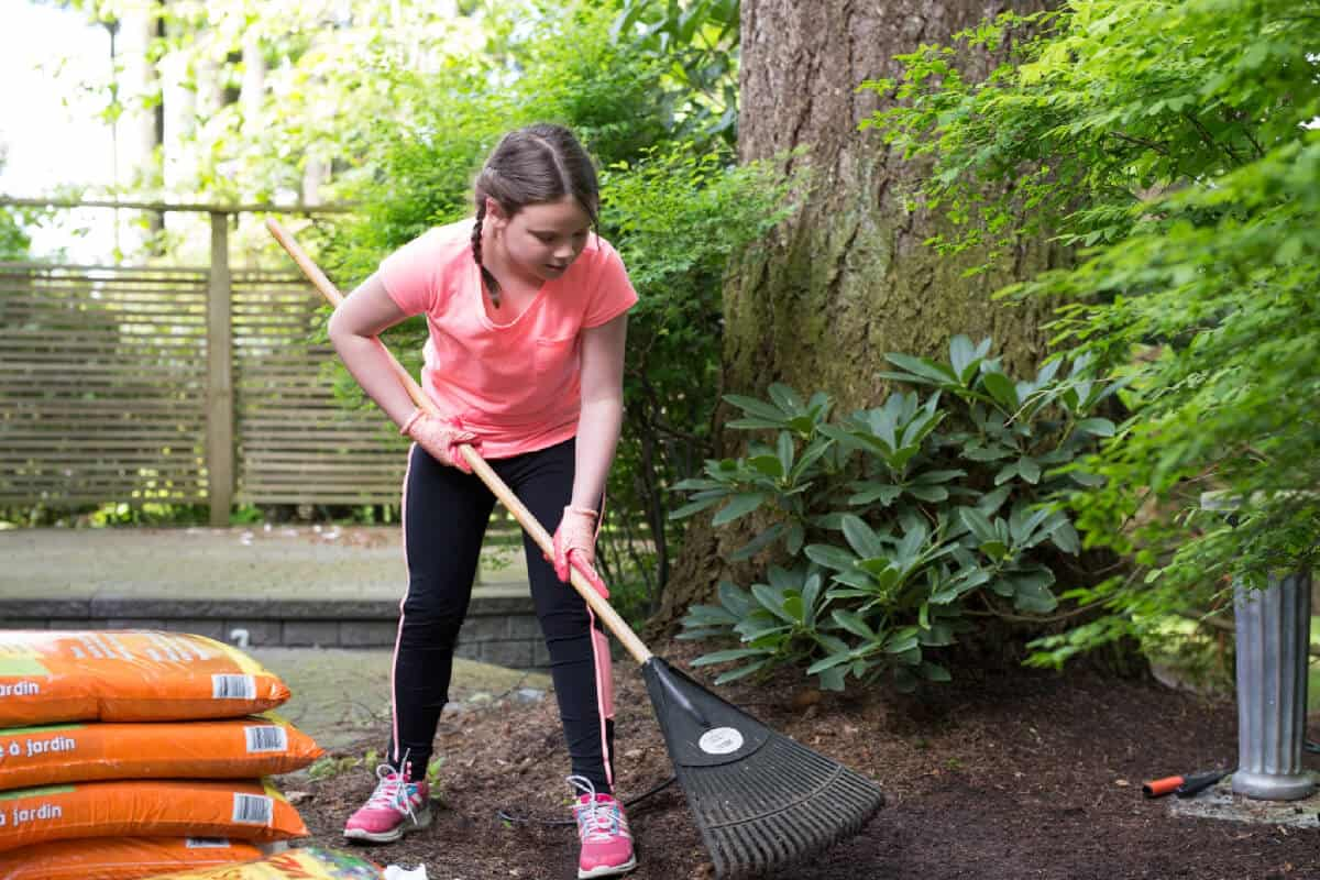 11 year old girl gardening in her backyard