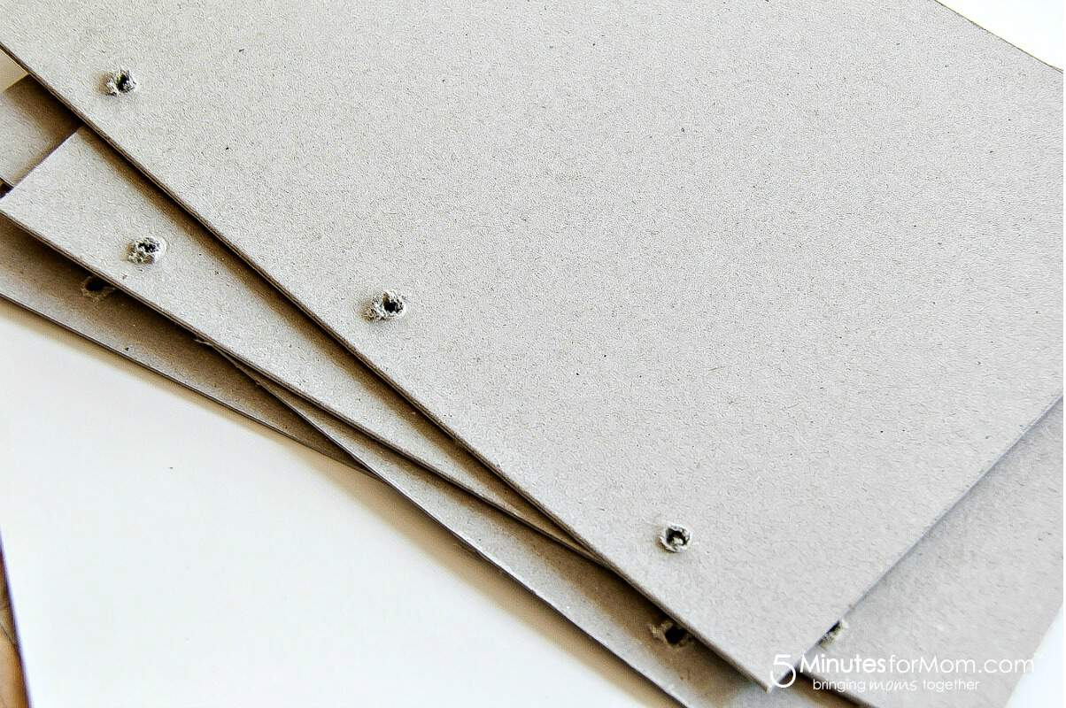 punch holes in the journal cover