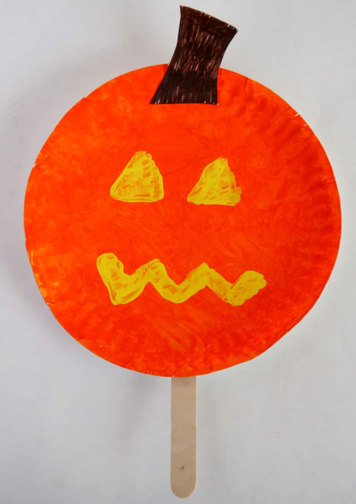 Pumpkin Paper Plate Halloween Stick Puppet
