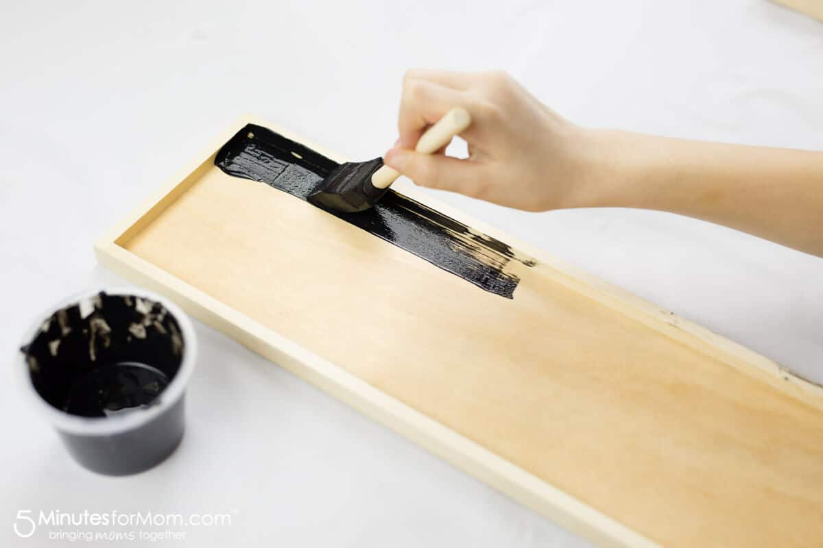 Painting Chalkboard Paint To Make DIY Photo Collage Frame