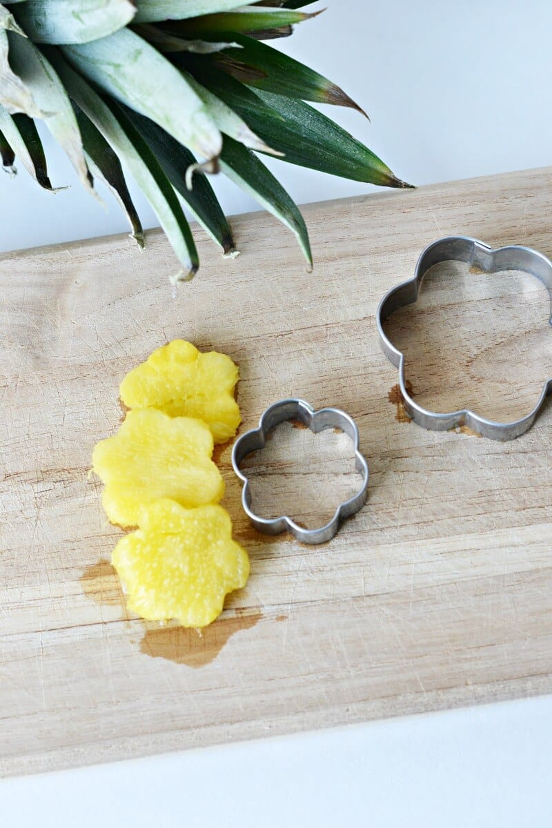 cutting pineapple with a cookie cutter