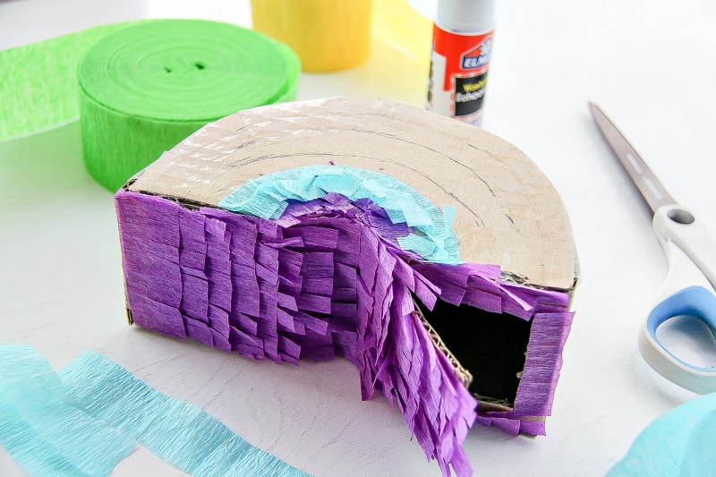 attach the crepe paper streamers to pinata