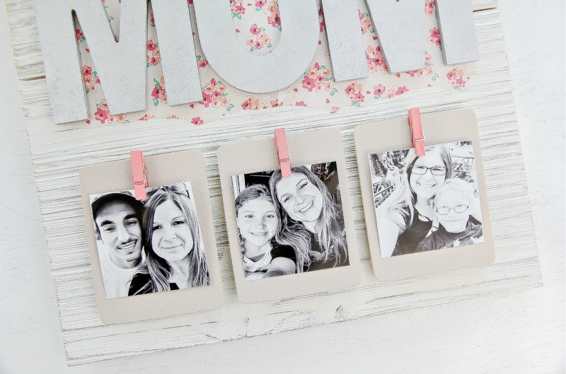 Attach photos to the pallet picture frame
