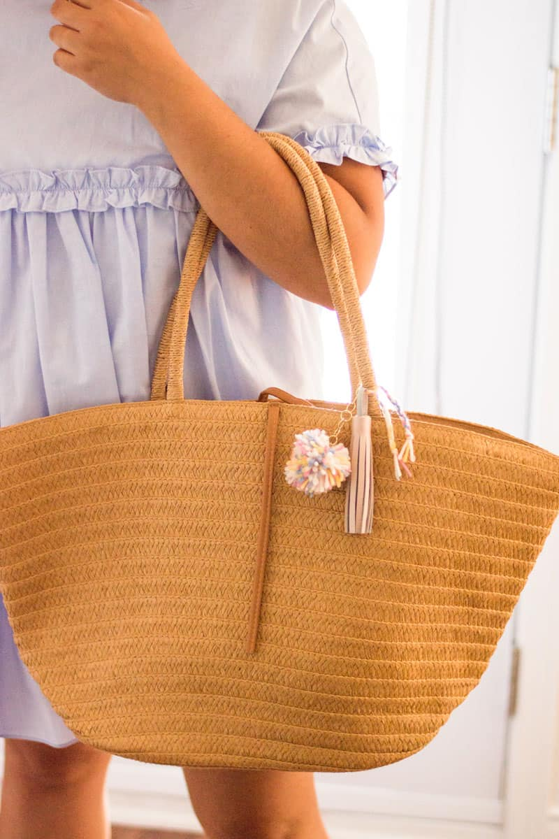 Adding a touch of color and texture to an otherwise neutral purse: here is how to make your very own DIY Tassel Keychain