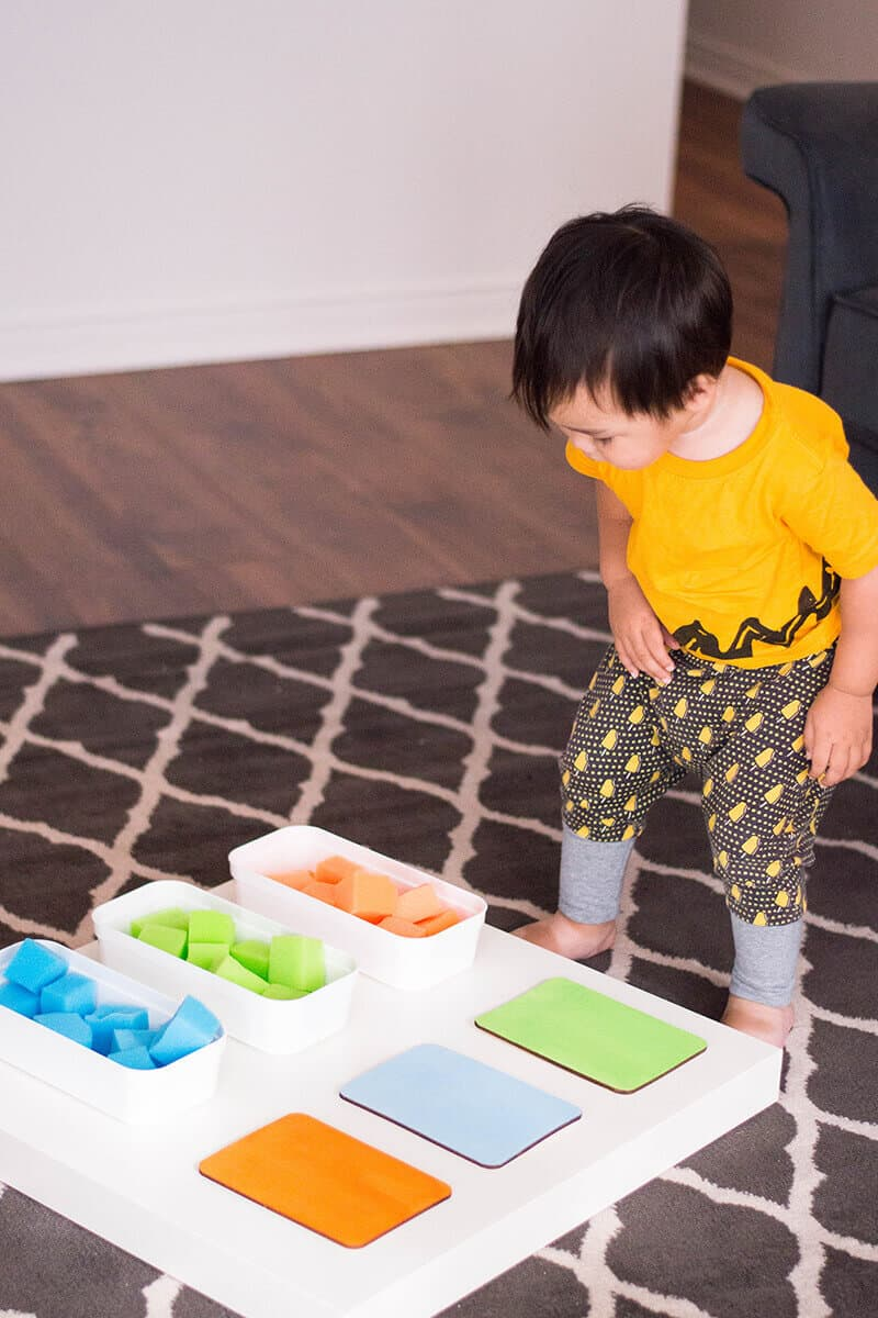 Toddler playing with color recognition activity for toddlers