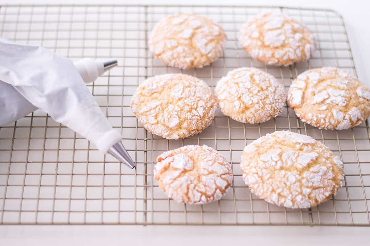 Giving our crinkle cookies a Halloween makeover with buttercream spiders.