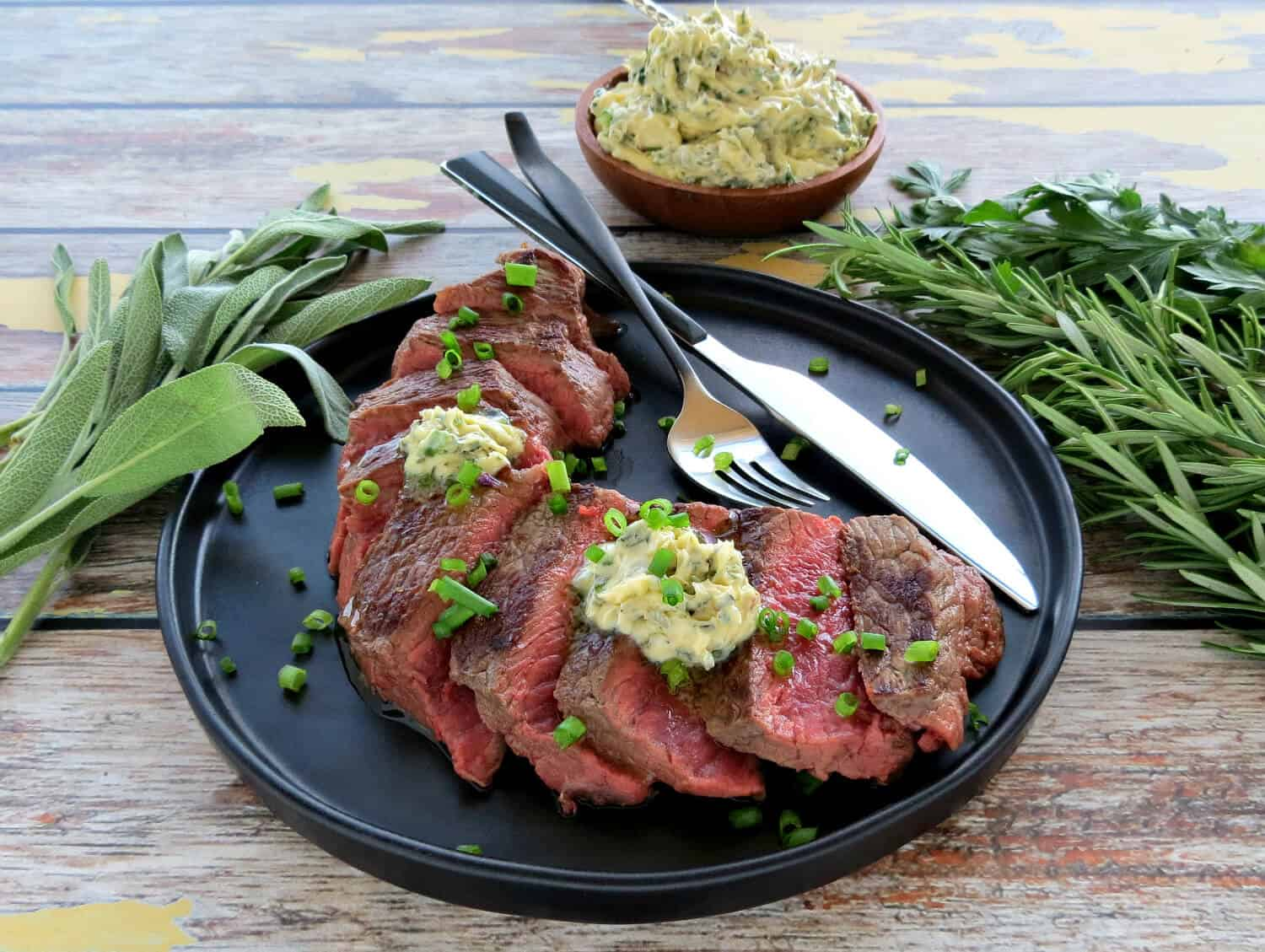 Easy Herb Butter served on Grilled Steak