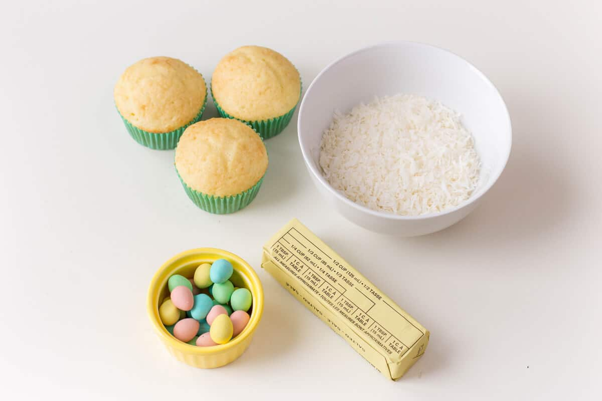 Ingredients for Bird's Nest Cupcakes - Vanilla cupcakes topped with buttercream, shredded coconut and candied eggs.