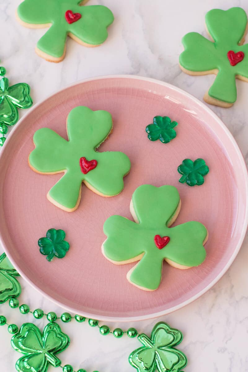 St. Patrick's Day Sugar Cookies - Lucky clovers with a frosted heart.