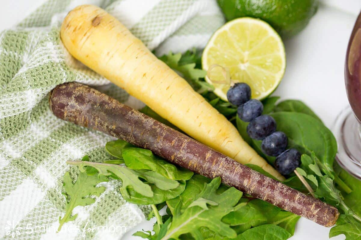 Healthy smoothie ingredients including purple carrots, and power greens