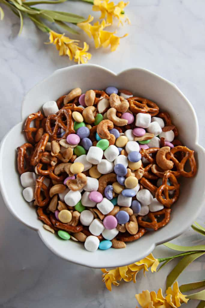 Easy Spring Snack Mix - snack mix in a white bowl on a white marble background