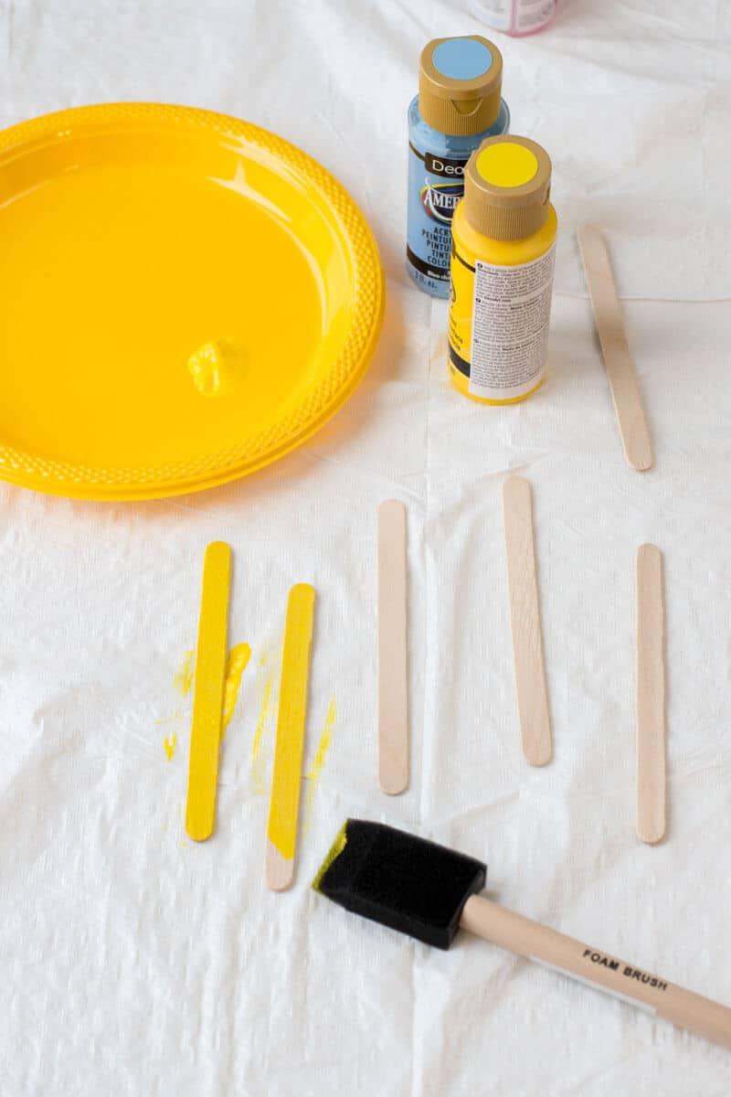 Painting Popsicle Sticks Yellow