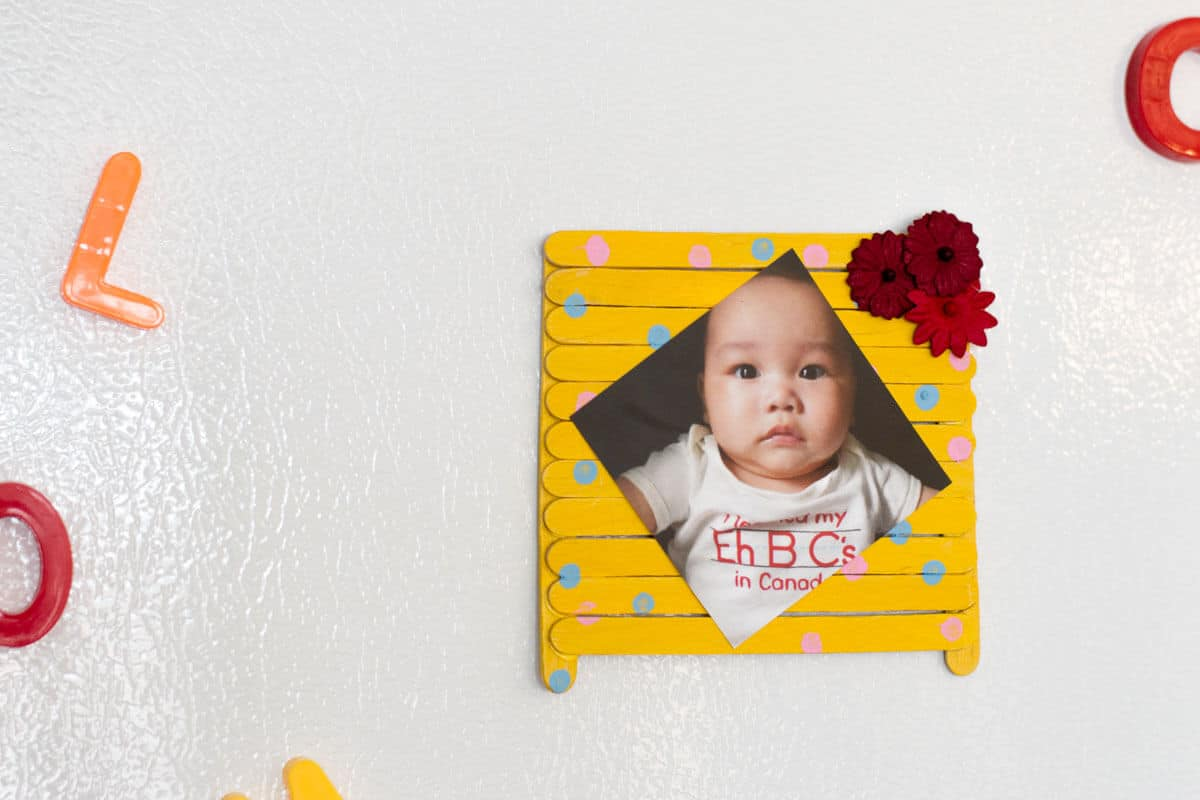 Popsicle Stick Picture Frame - A kid-friendly Mother's Day gift made up of popsicle sticks, paint, and your favorite photo