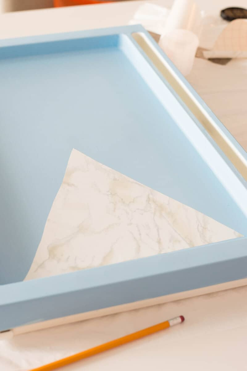 IKEA Hack - Apply marble contact paper to painted IKEA bed tray to make an easy breakfast tray DIY.