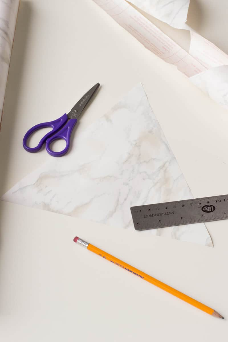 Cut the marble pattern contact paper