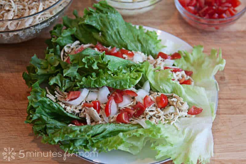 Greek Chicken Lettuce Wraps- Shredded chicken, on lettuce, on white plate