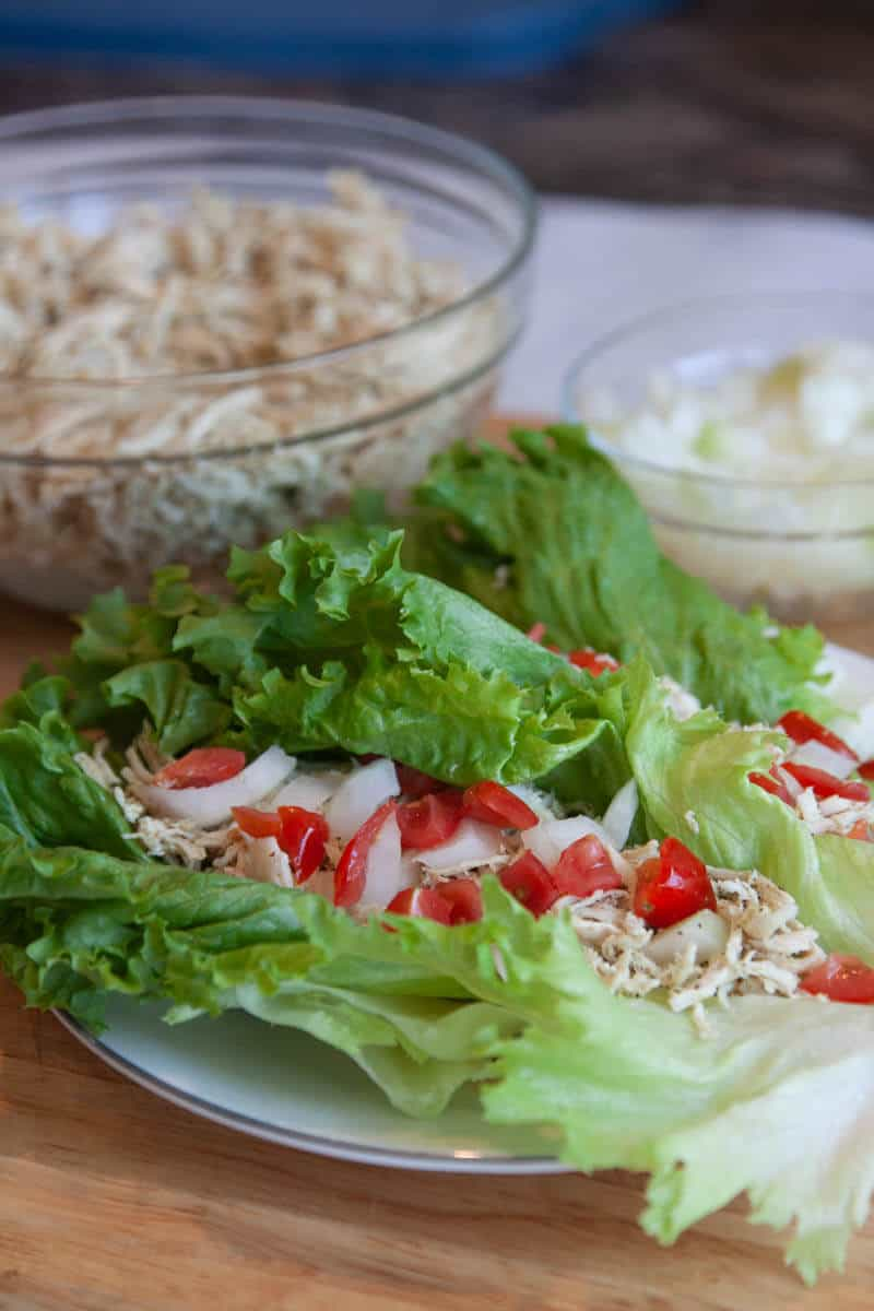 Shredded chicken lettuce wrap with tomatoes and onions