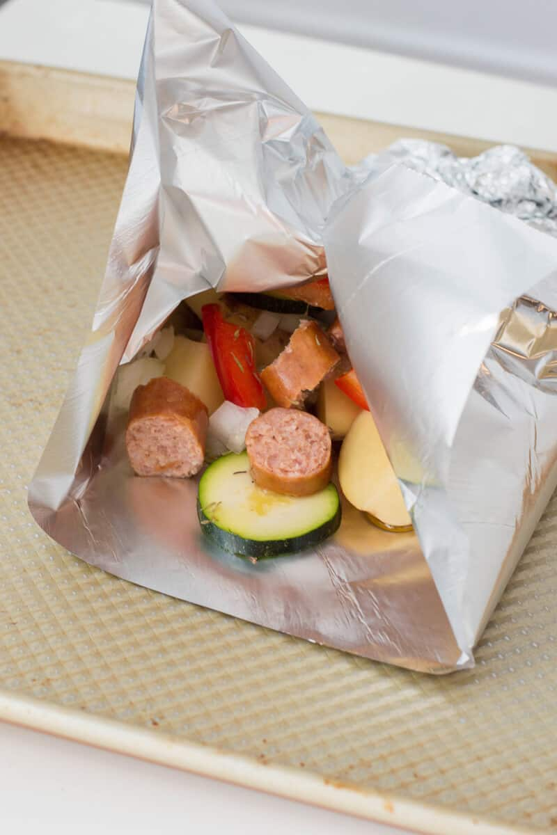 Sausage foil packets are the ideal meals to bring along your camping adventures. Follow along our easy recipe to make them for your family! #campingrecipes #foilpackets #5MinutesforMom