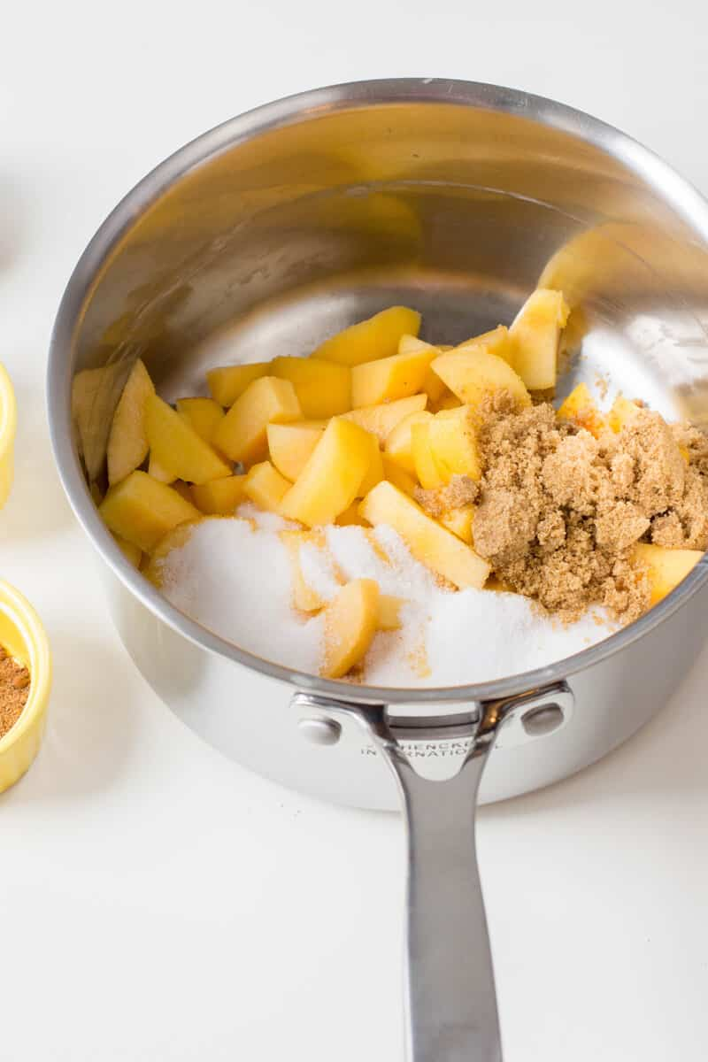 Place peaches and both sugars in a medium-sized saucepan and heat over medium-high.