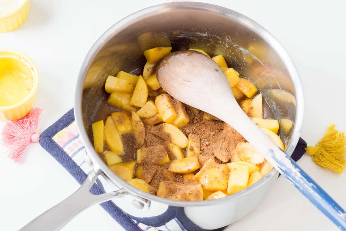 Add cinnamon and nutmeg to the filling mixture and stir.
