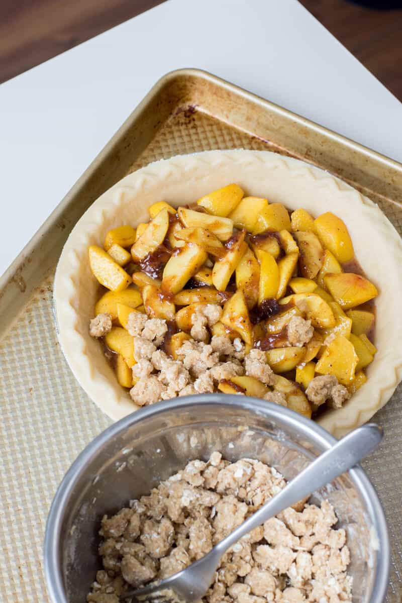 Add crumble on top of the Peach Crumble Pie