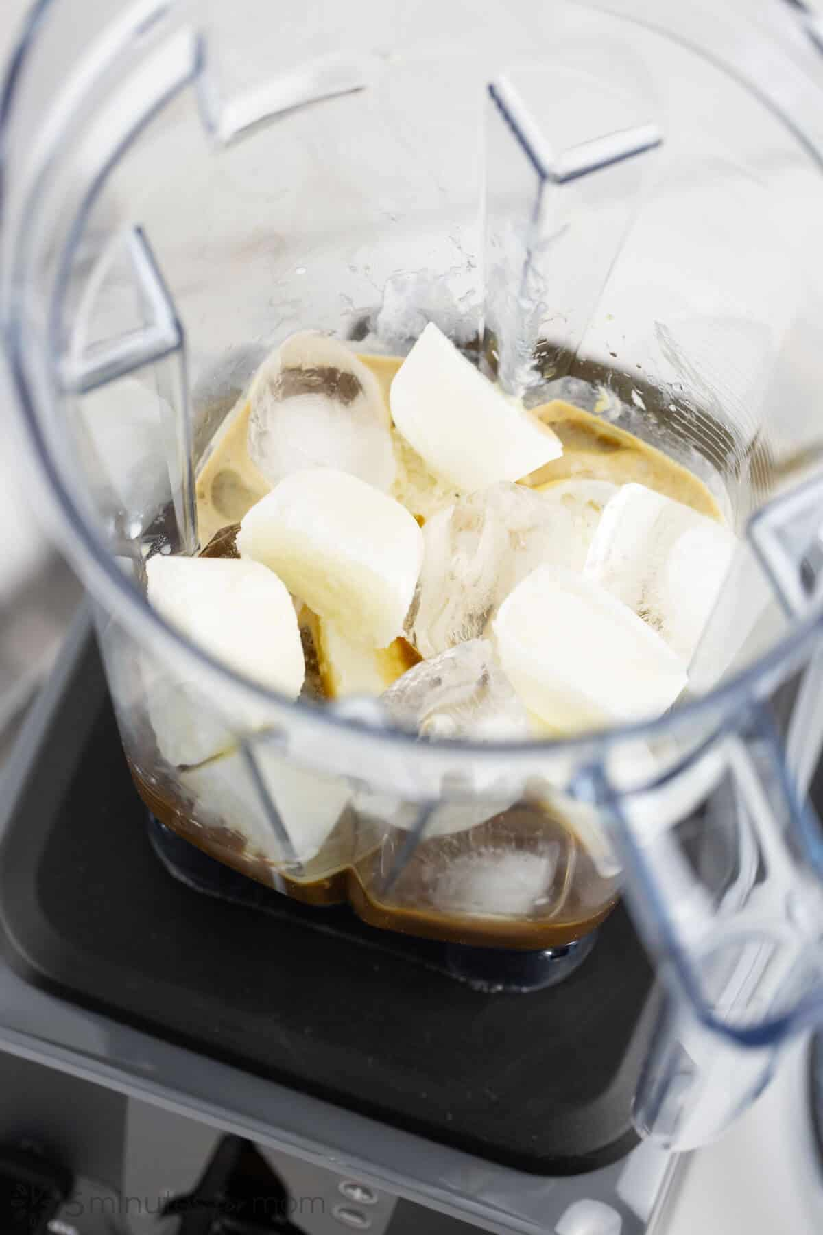 Blending milk cubes ice cubes and coffee