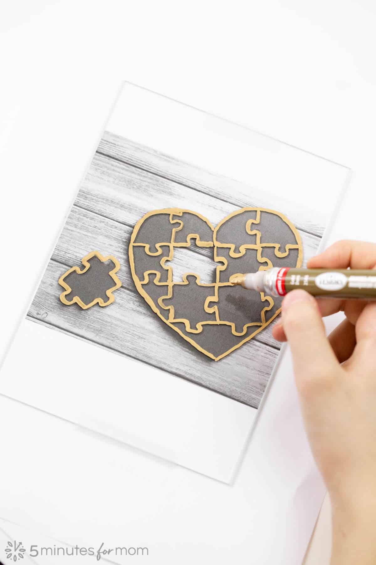 Trace heart shaped puzzle template with enamel paint pen