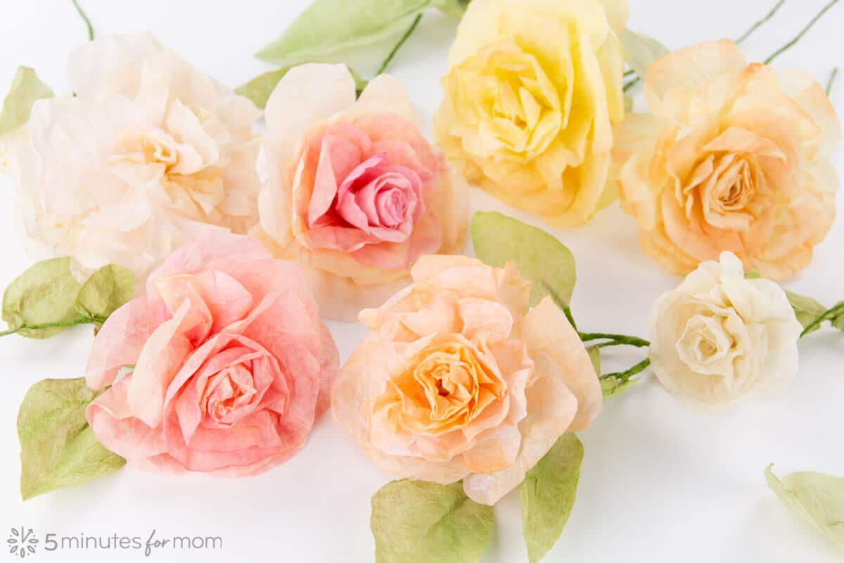 Coffee filter flowers in various shades of light pink and yellow.