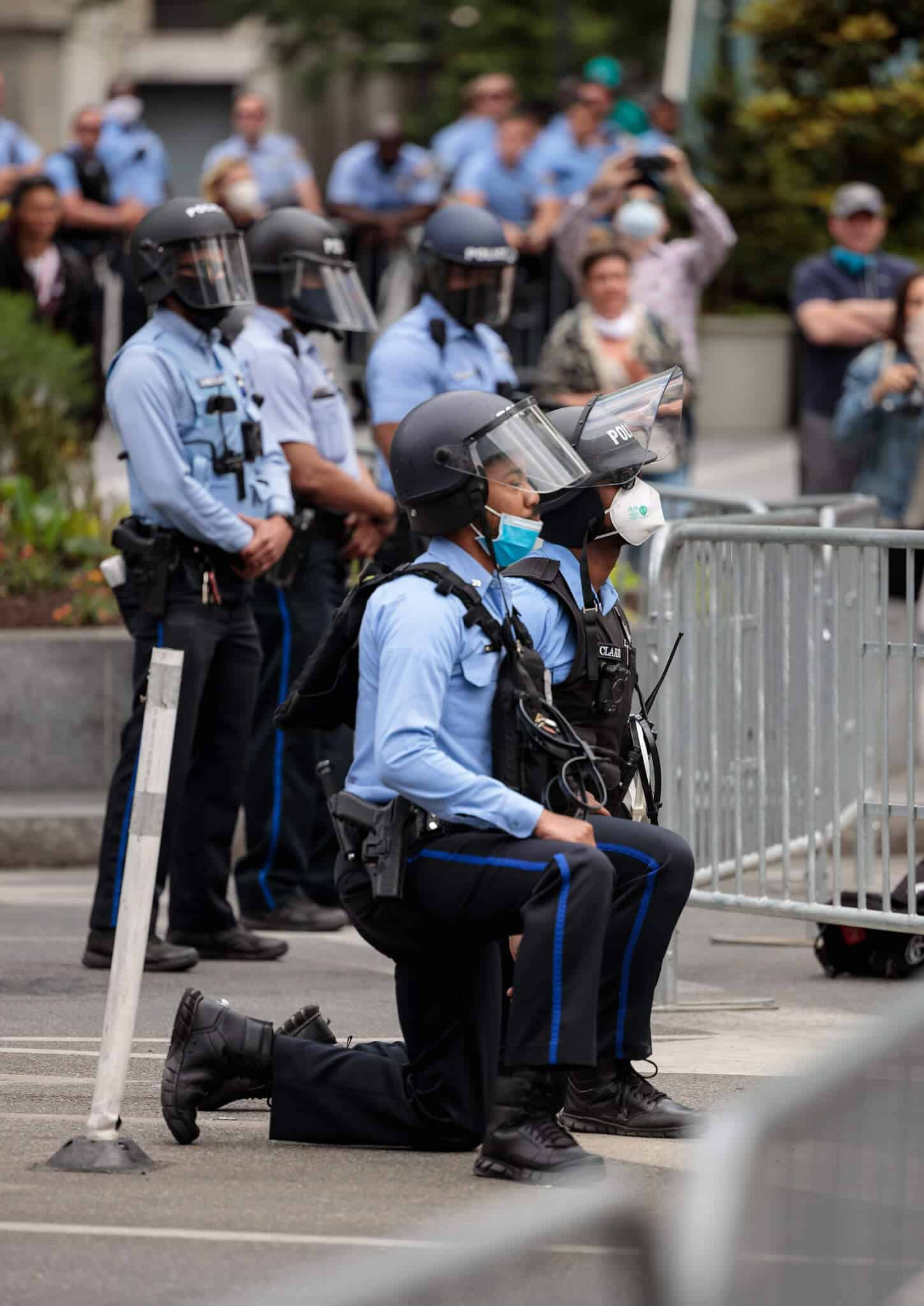 Police Taking a Knee - Photo by Rob Bulmahn