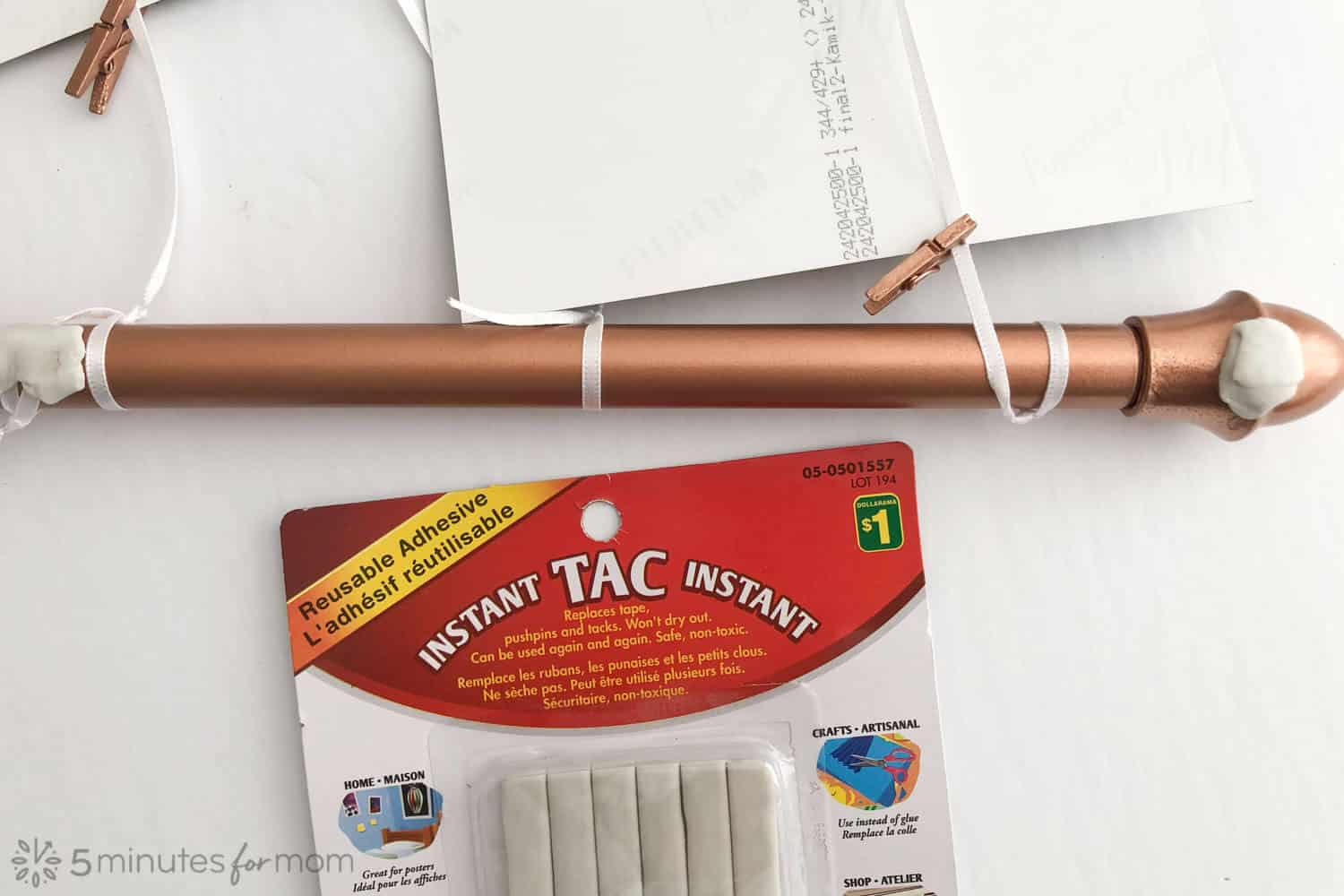 apply reusable adhesive tac to keep rod from scratching wall