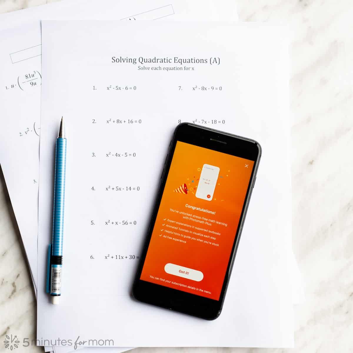 Photomath Plus on iPhone with Math Worksheet