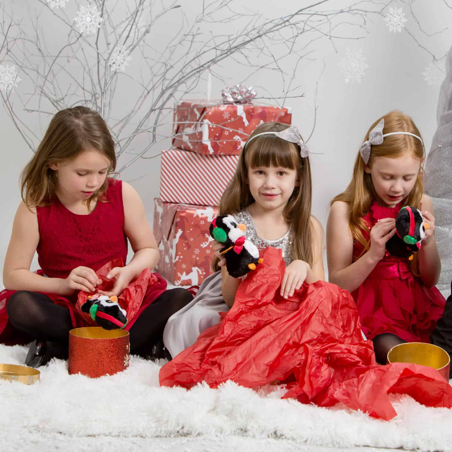 Girls opening Christmas gifts