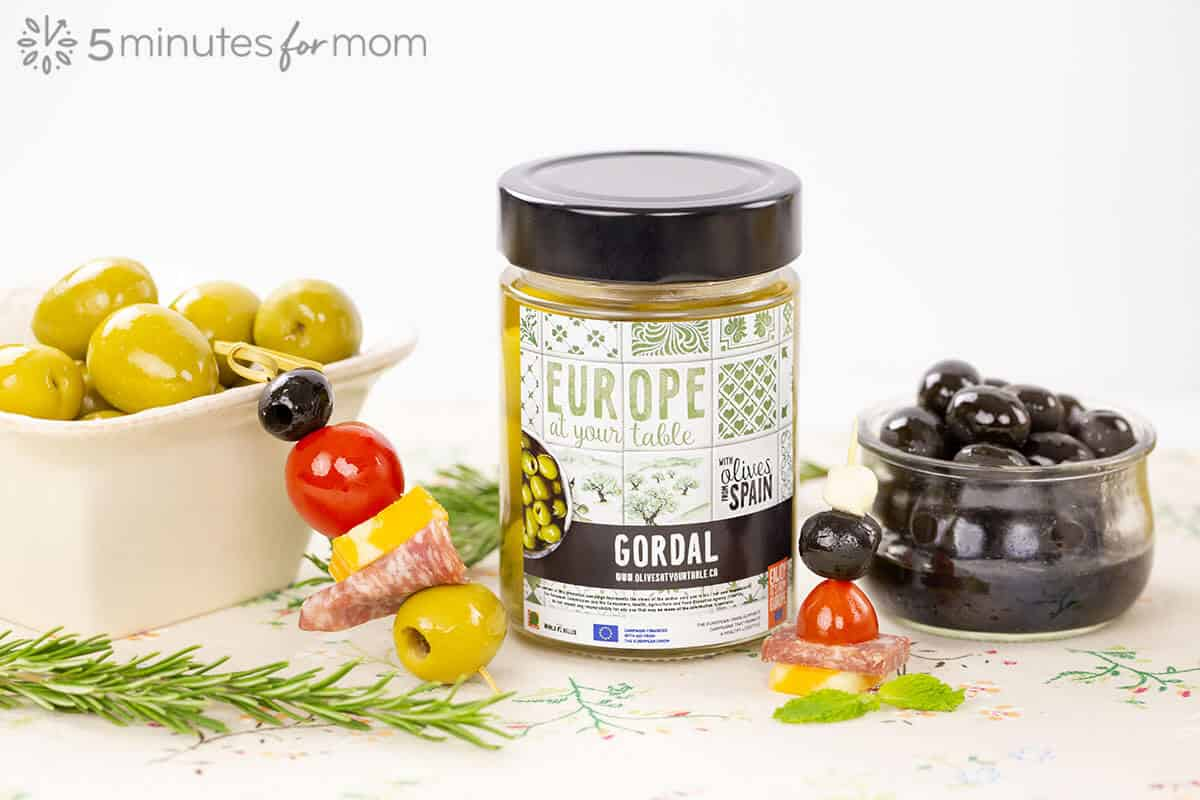 Gordal Olives in a jar and serving dish along with olive skewers