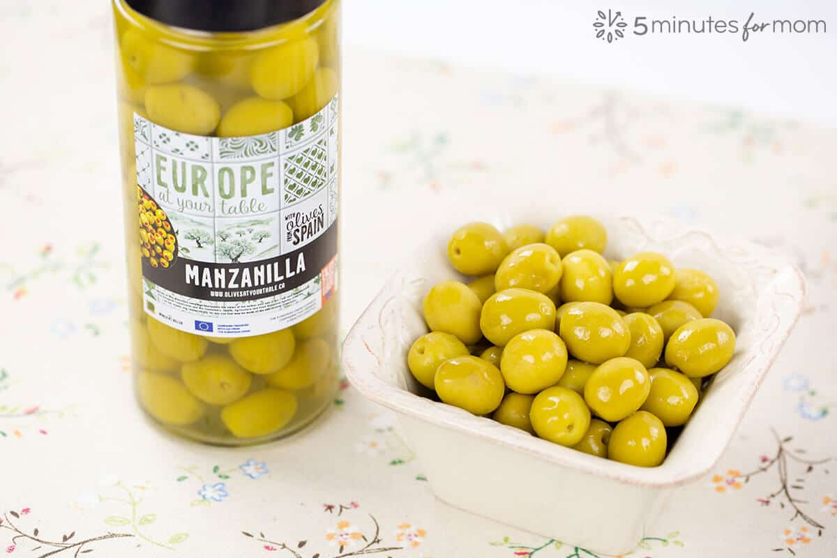 Jar of Manzanilla Olives and Olives in Serving Dish